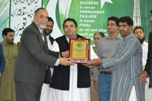 Receiving award from Sharjah Social center